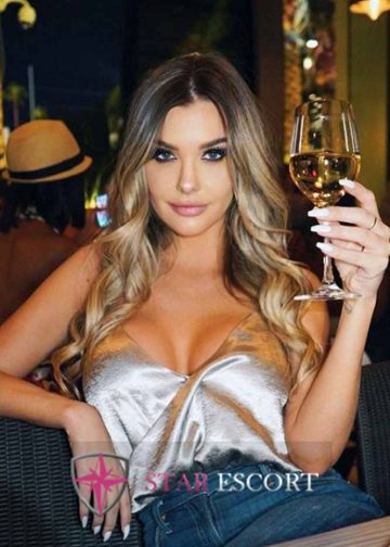 Gorgeous Amsterdfam escort girl drinking wine