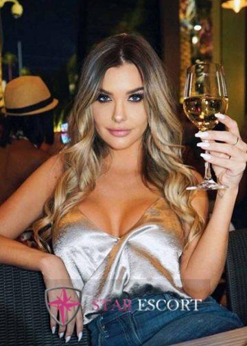 Gorgeous Amsterdfam escort girl drinking wine