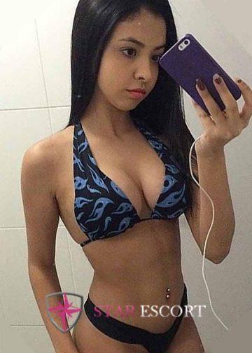 Hot escort lady taking selfie, wearing just a bikini
