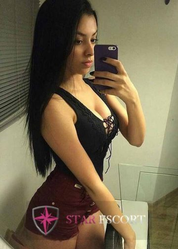 Stunning escort lady taking selfie in Amsterdam