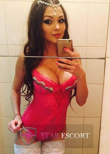 Stunning Amsterdam escort wearing hot pink dress